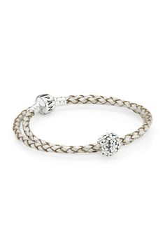 This champagne double leather bracelet with sterling silver barrel clasp is a must-have to add to your collection. Add a few white charms to be on trend. #PANDORA #PANDORAbracelet #PANDORAstyle