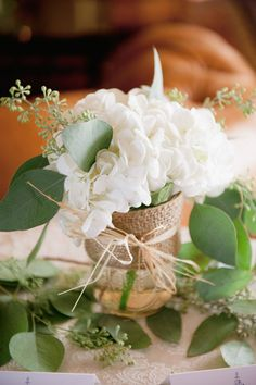 Simple burlap wrapped jar with crisp white hydrangea | New Jersey Mallard Island Yacht Club Upscale Nautical Wedding | Photograph by Off BEET Productions http://storyboardwedding.com/new-jersey-mallard-island-yacht-club-nautical-wedding/