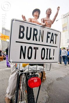 Photo © TristanSavatier - AllRightsReserved - No authorized use without written permission  Share this photo on: facebook • twitter • google+ • reddit • digg • stumbleupon • more...    Burn fat, not oil    Photo taken at an Occupy protest on Black Frid Start Burning Fat now, by eating the Right kinds of Food and Cut Out the 5 Foods never to eat.