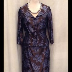Beautiful suit Perfect for office cocktails, conference functions. Feminine yet professional.  Silky Sheen brown with periwinkle blue flowers. The closest blue I can describe it. Like new. Maggy London Dresses