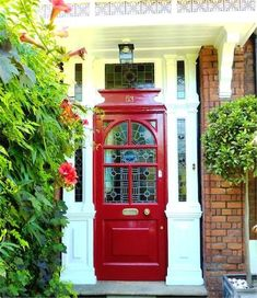 Red Lacquered Front Door and Brass Door Knocker I love this color ...