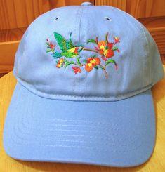 7ffad38e73a Hummingbird Embroidered on a Blue Baseball Cap. Hummingbird and Flowers on  a Baseball Cap
