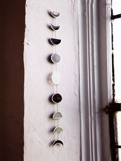 OMG I NEED THIS!!!!!!!!!! ABJ Glassworks Moon Phase Chime at Free People Clothing Boutique