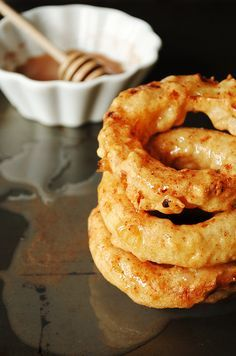 APPLE RINGS~ 1 large egg white, 1 cup water, 1 tbsp vanilla, 1 cup all-purpose flour, ¼ tsp salt, 6 large apples peeled, Canola Oil for frying, cinnamon and sugar. For the icing: 4 tbsp butter melted, 1/3 cup sugar, 1 tbsp cinnamon, 2 tbsp milk, 1-1 ½ cups powdered sugar.