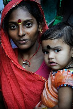 Indian Mother. Colourful beauty. Maternal love.