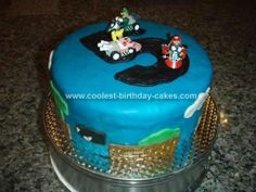 Homemade Mario Brothers Birthday Cake: My son was turning 5 and asked for his first 'big boy' party.  He's really into videogames so he asked for a Mario Bros. Party.  So this Mario Brothers