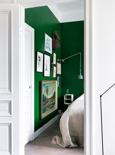 bright green walls, crisp white trims, and uniquely hung art ...Jonas Ingerstedt
