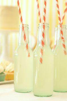 Glass bottles for lemonade with paper straws