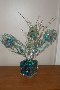 Sparkly peacock feather centerpiece