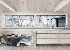 Aslak Haanshuus transforms Norwegian log cabins into a house