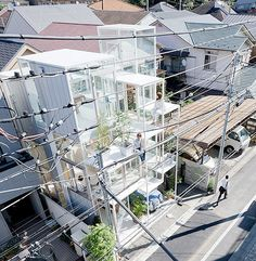 Modern single family house with floor-to-ceiling glass windows is located in a quiet neighborhood in Tokyo, Japan.