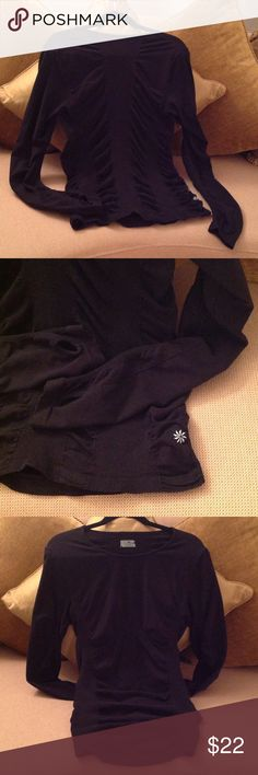🐞 'Athleta' - Fastest Track Top Excellent condition Fastest Track Top size XL. Deep Black with rusching all over the body and arms.  And it has 'Thumb Holes'!!  Check out the  Silver Athleta insignia on the front hem. This is really cute and stylish. Made of Organic Cotton and Spandex. Nice hugging fit!!  Price is firm unless bundled 🐞 Athleta Tops Tees - Long Sleeve