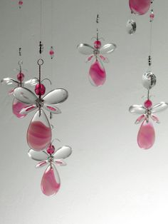 This Pink Fairy / Angel chandelier hanging mobile has been hand crafted from…