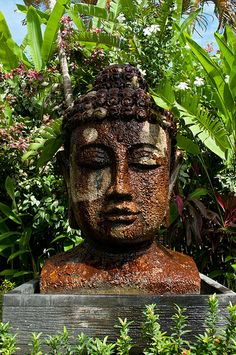 Buddha statue surrounded by greenery, in Legian Bali, by Lucy from OnTheLuce.com
