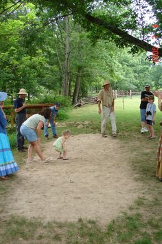playing marbles at past Independence Day Celebration. Learn to play at this year's July 4 celebration