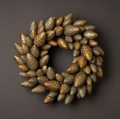Painted pinecone wreath!  Under The Table and Dreaming: 70 Unique and Unusual Christmas Holiday Wreaths {Saturday Inspiration & Ideas}