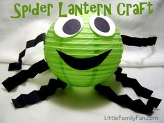 To make a Spider use a green lantern, black & white construction papers & double stick tape.