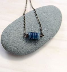 This necklace includes five kyanite gemstones to symbolize the five deep breaths. Each time you see them, let them be a reminder to you to pause and take those deep breaths. Kyanite invites you to speak your truth.