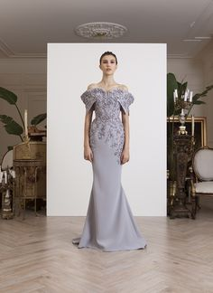 Off-shoulder, fishtail, light gray crepe gown with sequined floral embellishments