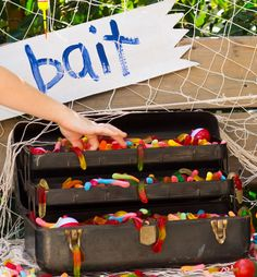 A tackle box full of gummy worms serves as a quick refueling station.