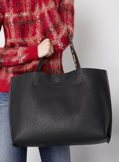 Black vegan leather tote bag with leopard print lining