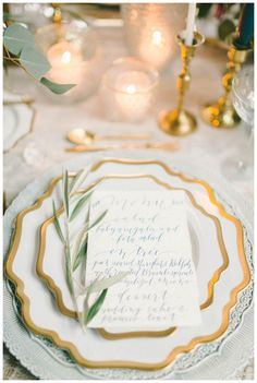 Wedding place setting with gold accents. Event planning and styling by Kari Rider Events, florals by Crimson & Clover Floral Design, Inc., place settings of gold-rimmed china, gold flatware and crystal from Casa de Perrin, silk runner by Silk & Willow, menu in blue calligraphy by Laura Hooper Calligraphy. Image by Elizabeth Fogarty.