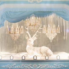Magical window display at Tiffany on Champs-Élysées this evening, complete with miniature chandeliers. More @aparisianmoment