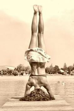 Vintage yoga at the edge of the dock.