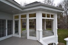 enclosed deck area with stone tile floor (keeps bugs out) and fireplace and big windows. Add sky lights and hot tub - perfect! Outdoor Rooms, Outdoor Living, Outdoor Decor, Enclosed Decks, Hot Tub Room, Stone Tile Flooring, Three Season Porch, Backyard Gazebo, Big Windows