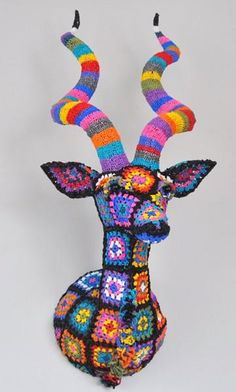 "Amazing crochet animal ""trophies"" by Magda Van Der Vloed (website is in Spanish with Google translate available)"