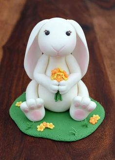 Sweet fondant bunny cake topper for a springtime party, created by Adorn Cake Design.