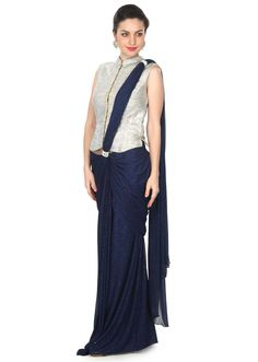 ‌Navy blue saree gown featuring in shimmer lycra. Its enhanced in pre stitched pallav. Matched with kundan embellished long jacket blouse. Indian Attire, Indian Outfits, Indian Wear, Indian Designer Outfits, Designer Dresses, Navy Blue Saree, Saree Gown, Modern Saree, Look Short