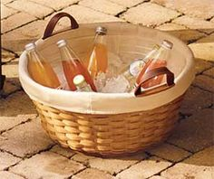 Use a basket with a plastic protector as a fun and elegant beverage cooler. Perfect for a family get together or backyard barbeque!