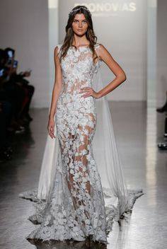 Pronovias Bridal Market NYC 2016 // Sheer Lace wedding dress with a draping cape.