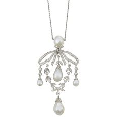 Belle Epoque Platinum, Natural Pearl and Diamond Pendant-Necklace. The pendant of stylized bow and garland motif, highlighted by 5 pearls and set throughout with small old-mine, single and rose-cut diamonds, circa 1910.