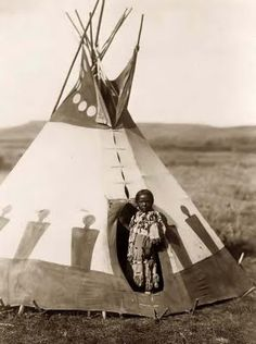 Teepee & Indian standing in doorway