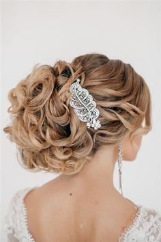 long loose low wedding updo for bride