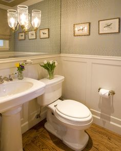 Make a small bathroom appear larger by making the entire back wall a mirror.  Add wainscoting and wallpaper to give it some character.