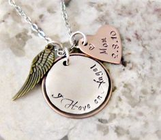 I Have An Angel Hand Stamped necklace is stamped on a 1 sterling silver circle pendant and has been soldered to a copper pendant. A copper heart pendant is added so you can add the name andor date on this pendant. Also featured is a brass angel wing charm. Includes a 20 stainless steel cable chain.
