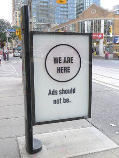 Toronto Hacktivists Morph Sidewalk Billboards Into Street Art Canvases
