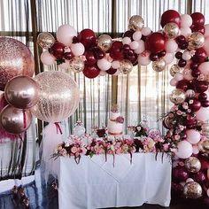 Beautiful balloon arch as a backdrop for a special table #redwedding #balloon #weddingideas