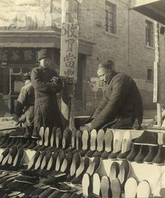 Picture Show: Memory of Old Beijing - Photographer: Hedda Morrison (1908-1991). Shoe Vendor on a Beijing Street (This picture was taken in the late 1930's)