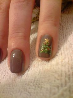 Xmas tree - think outside the normal holiday colors - here we have a nice taupe base with just a single accent tree art nail