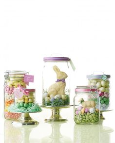 Chocolate bunnies, jelly beans, and cream-filled eggs! These are the candies we look forward to every spring. Easter is one of the biggest candy holidays, second only to Halloween. If you're looking to make a new tradition, here are a few ideas to add to your sweet celebration. Easter Candy ParadeBored with baskets this year? Try a sleek yet festive alternative to the traditional woven containers: Here, we filled glass food jars with Easter candy and white chocolate molds, and placed th...