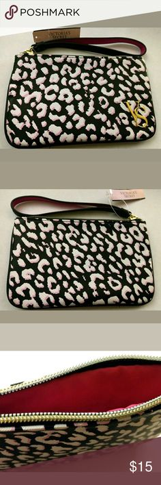 Brand New with tags Victoria Secret zip up clutch! Black, white and pink new clutch. Bright pink liner. Comes from a smoke free home Victoria's Secret Bags Clutches & Wristlets