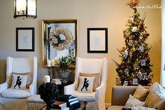 family photos in black & white on tree + ruffle wreath