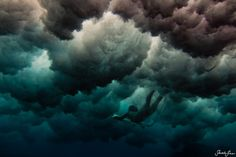 Flying through the storm? No. Swimming under the wave. (Sarah Lee's underwater photography)