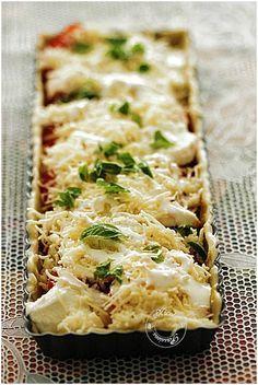 Tarte à la tomate, mozzarella, emmental, moutarde, basilic......sur son lit de roquette