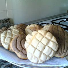 Conchas (Mexican Sweet Bread) Allrecipes.com   I made these last night  they made the house smell sooooo good and Ramon was in heaven