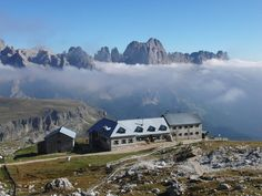 View of the Schlern House in front of the Catinaccio Group (Rosengarten) in the Dolomites mountain range, located in north-eastern Italy
